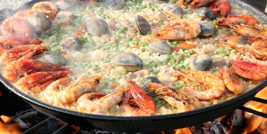 Grandmother Mary likes eating paella